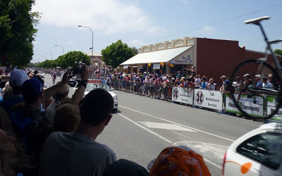 Riders and support cars approaching finish line