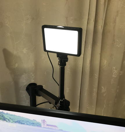 Light on stand behind monitor